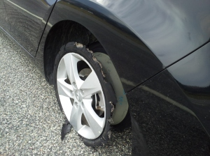 This is Johnny's wheel, after the tire blew out on the highway. This thing set off a chain of events we've been dealing with for 11 days now.