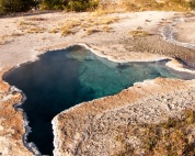 This is one of the many crystal clear springs in Yellowstone. The water is so transparent, you can see several feet down into the pool.